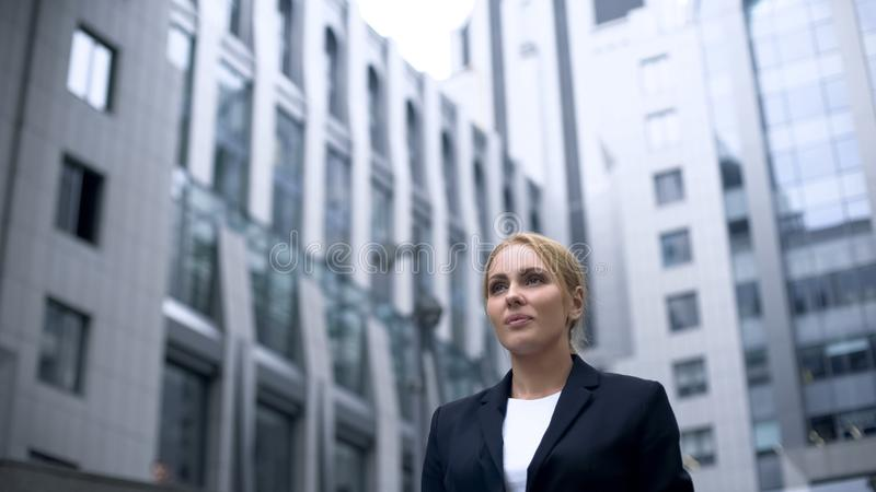 Female standing at business center, full of determination, gender equality. Stock photo royalty free stock photo