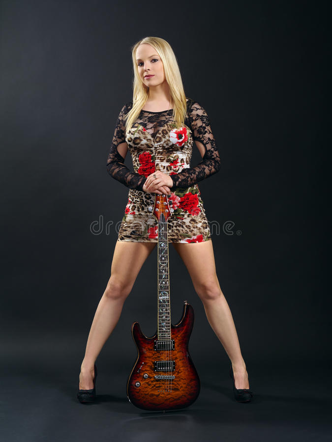 Download Female Standing With Electric Guitar Stock Image - Image: 29192927