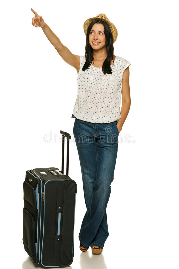Download Female Standing With Suitcase Pointing To Side Stock Photo - Image: 26313622