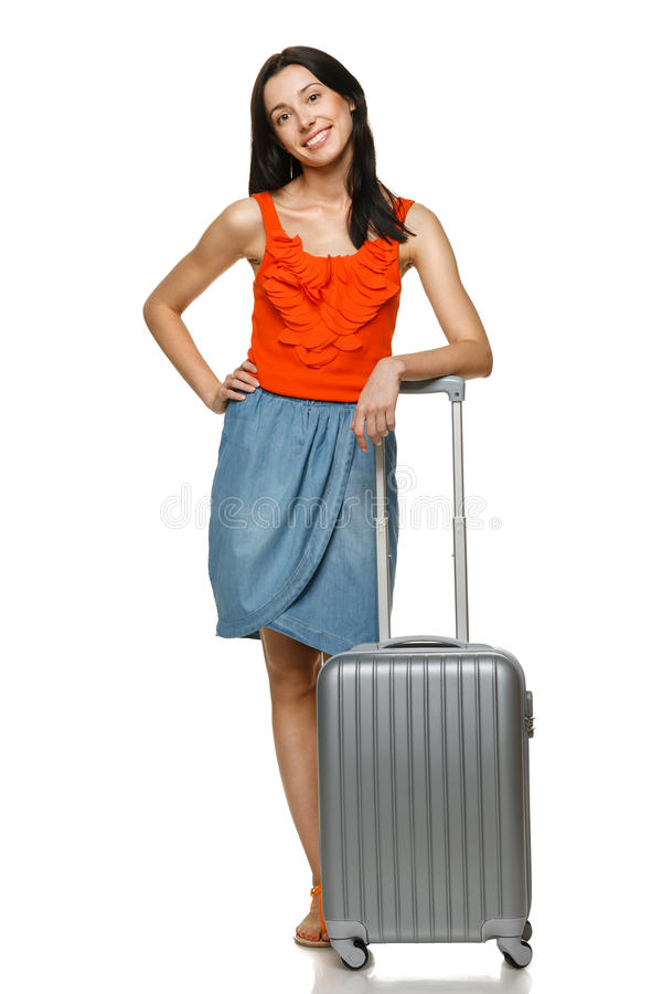 Female standing with travel suitcase. Full length of young trendy female standing with siver suie btcan whits, on white background royalty free stock images