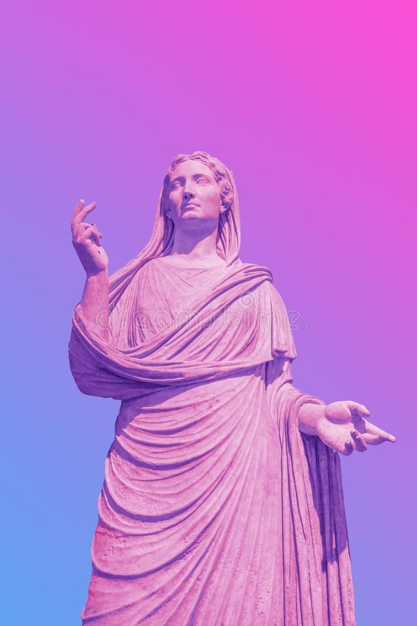 Female statue in bold pink and blue neon colors on gradient background. Minimal art fantasy concept stock photos