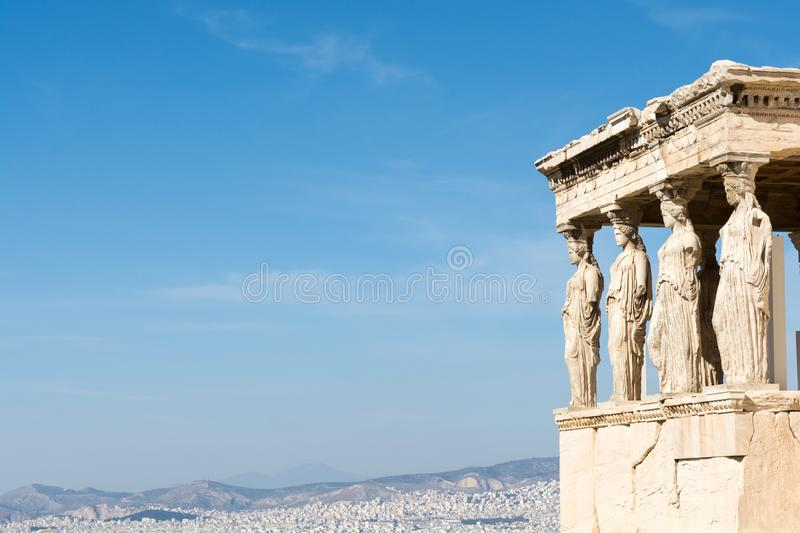 Female statues called caryatids in the Erechtheion at Acropolis. Female statues called caryatids in the Erechtheion at the sacred rock of the Acropolis of Athens stock photos