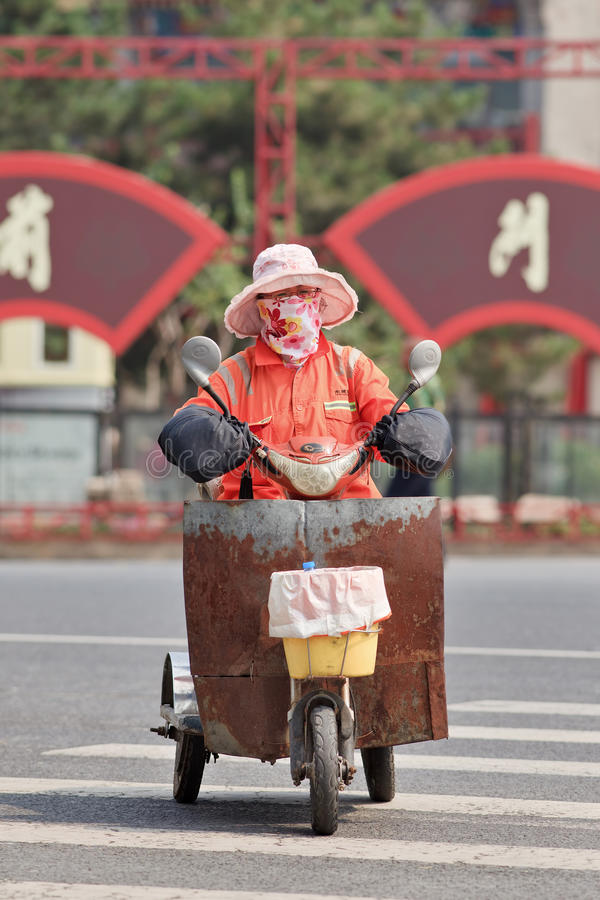 Female street sweeper on a tricycle in city center, Beijing, China stock images