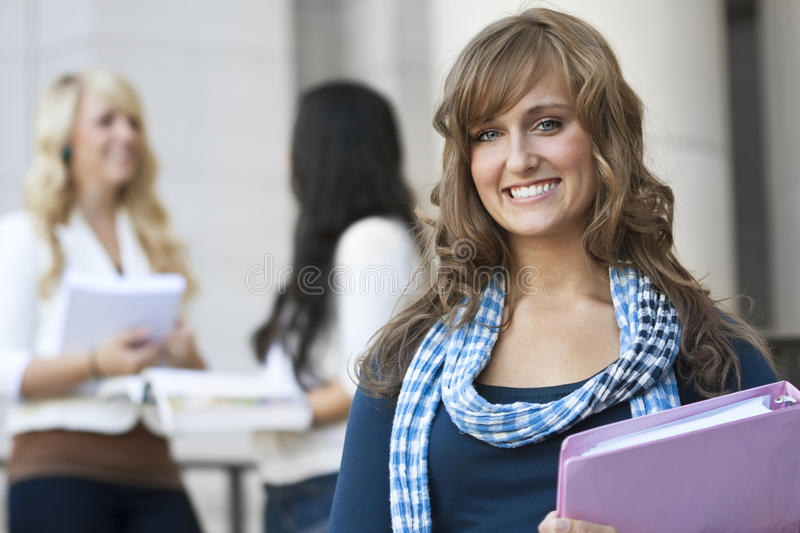 Female Student. An attractive female college student portrait outside of a school building royalty free stock photo