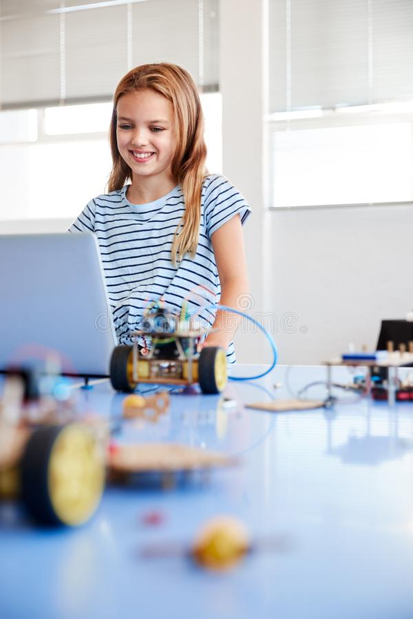 Female Student Building And Programing Robot Vehicle In After School Computer Coding Class royalty free stock photos