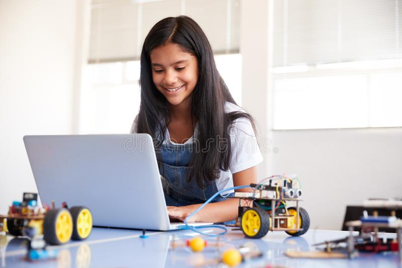 Female Student Building And Programing Robot Vehicle In After School Computer Coding Class royalty free stock images