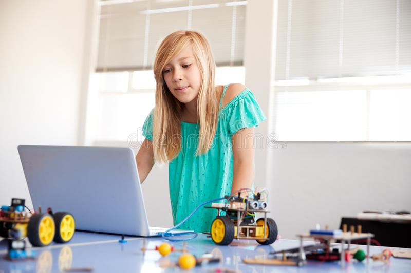 Female Student Building And Programing Robot Vehicle In After School Computer Coding Class stock photography