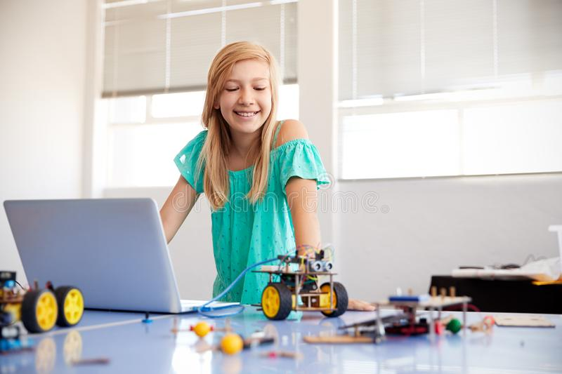 Female Student Building And Programing Robot Vehicle In After School Computer Coding Class royalty free stock photography