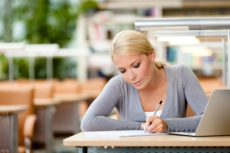 Female student drilling at the desk stock photo