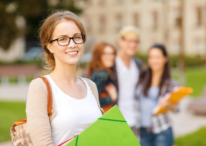 Female student in eyglasses with folders stock photos