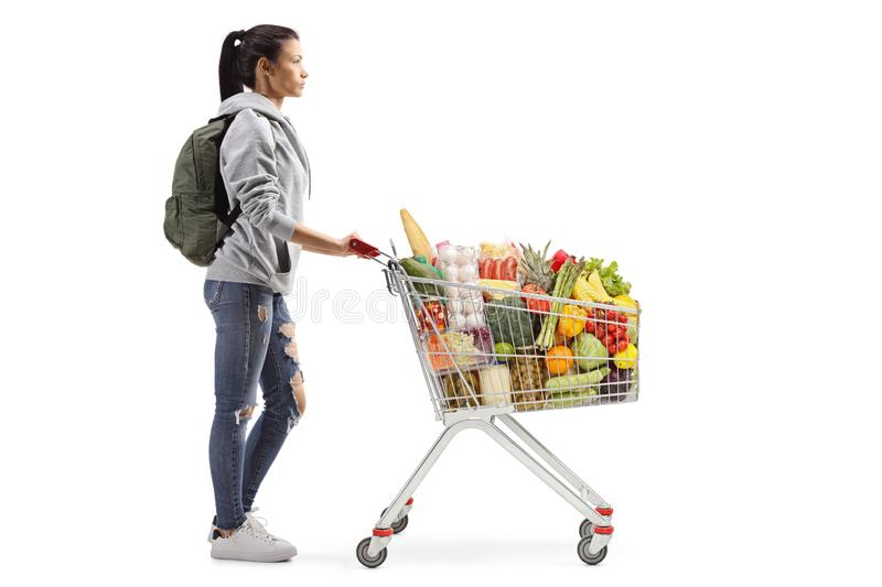 Female student with food in a shopping cart stock photography