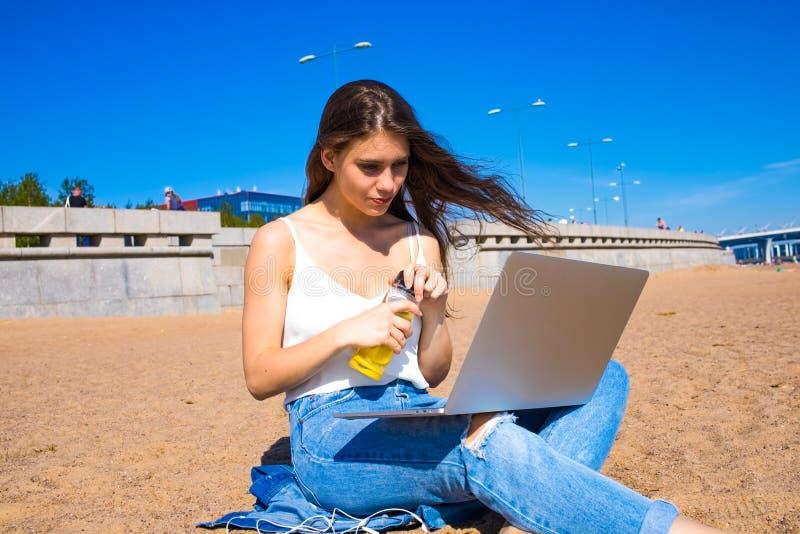 Female student having online education via notebook stock photo