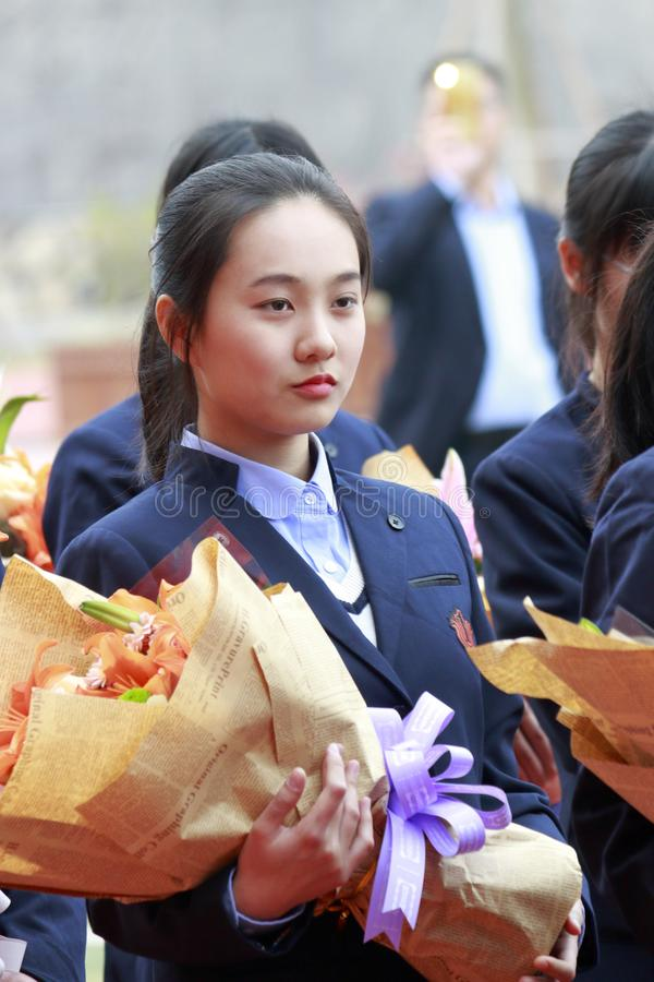 Female student holding flowers ready to dedicate to teacher, adobe rgb. December 30, 2017, students of Xiamen No. 1 Middle School held an adult ceremony. 18-year royalty free stock images