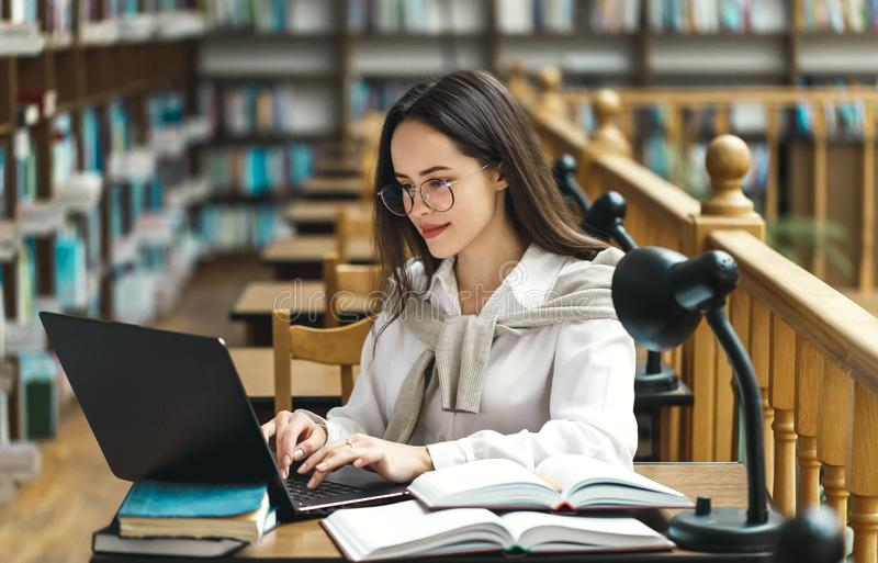 Female Student with Laptop and Books royalty free stock photos