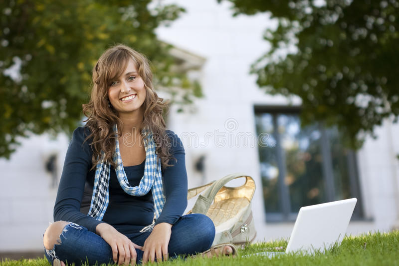 Female Student Portrait. A young, attractive female student outside studying on her laptop computer stock photos
