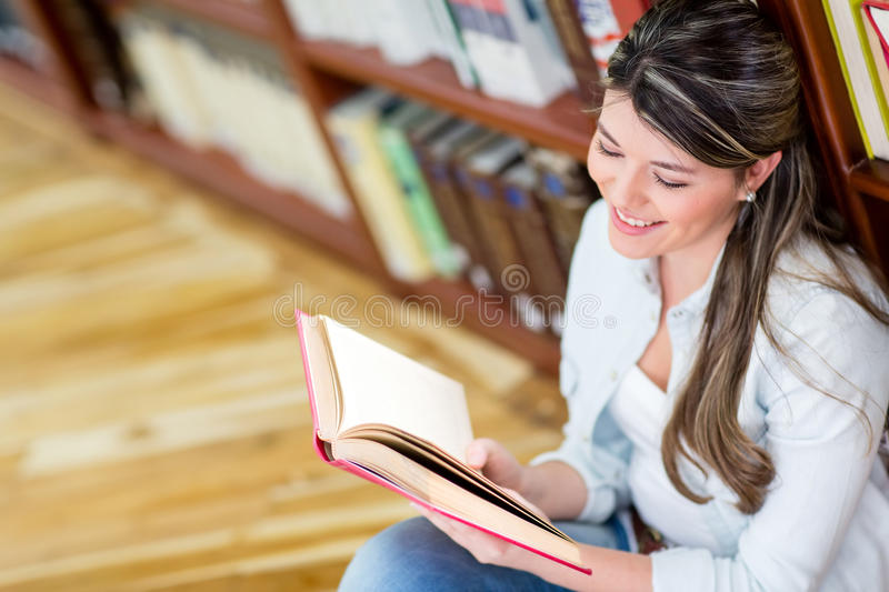Female student reading a book