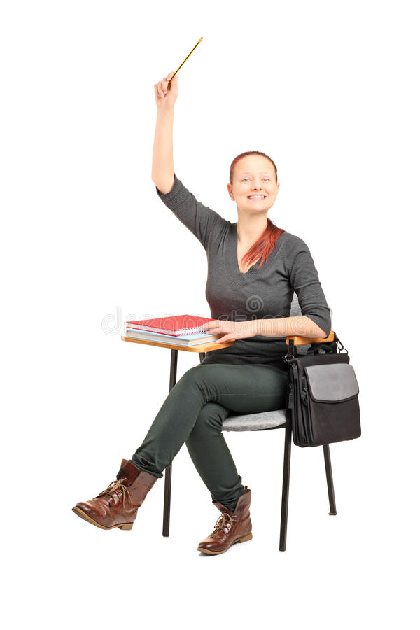 Download Female Student Sitting On A Chair And Raising Her Hand Stock Image - Image: 28158767