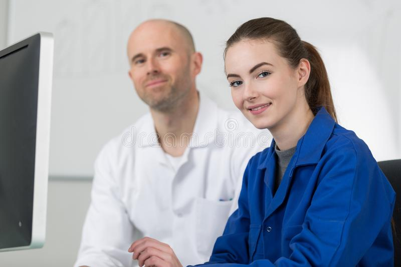 Female student smiling at camera in computer class royalty free stock photos