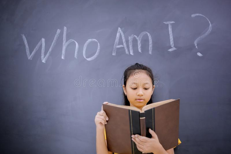 Female student standing with text of Who Am I royalty free stock images