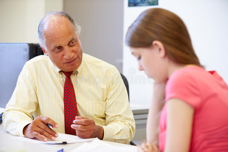 Female Student Talking To High School Councillor royalty free stock photo