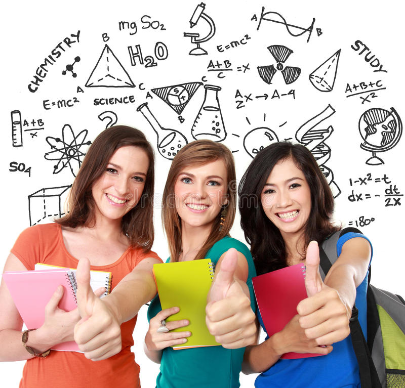 Female student together showing thumbs up stock photo