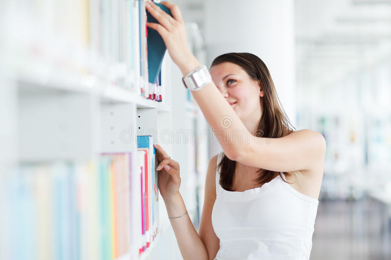 Download Female  Student  In The University Library Stock Photo - Image: 25109986