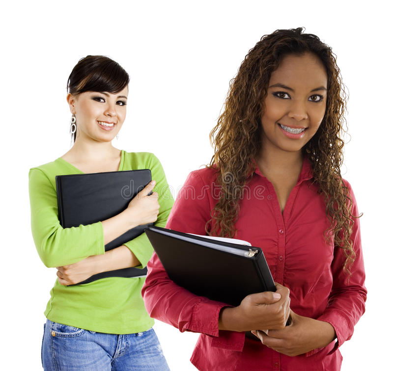Female Students. Stock image of two female students over white background