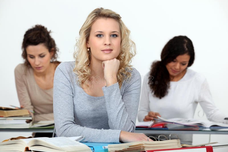 Female students in class royalty free stock photo