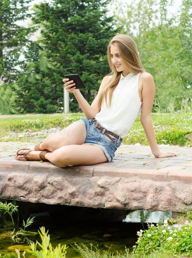 Download Female Studing Using Tablet Stock Image - Image of park, internet: 25610003