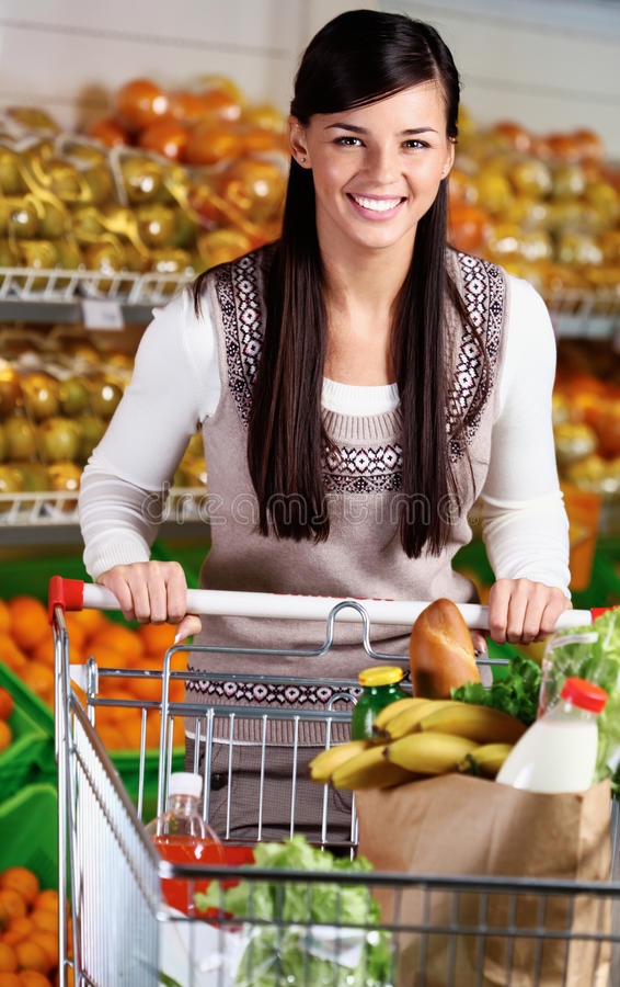 Female in supermarket stock photography