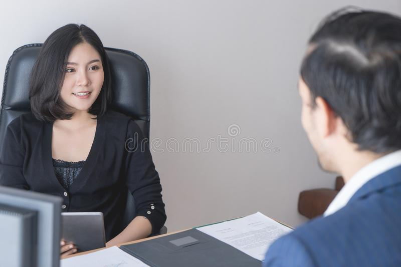 Female supervisor interviewing a new male staff stock photography