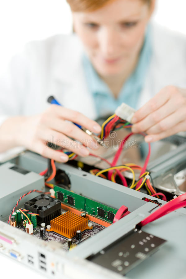 Female support computer engineer - woman repair royalty free stock photography