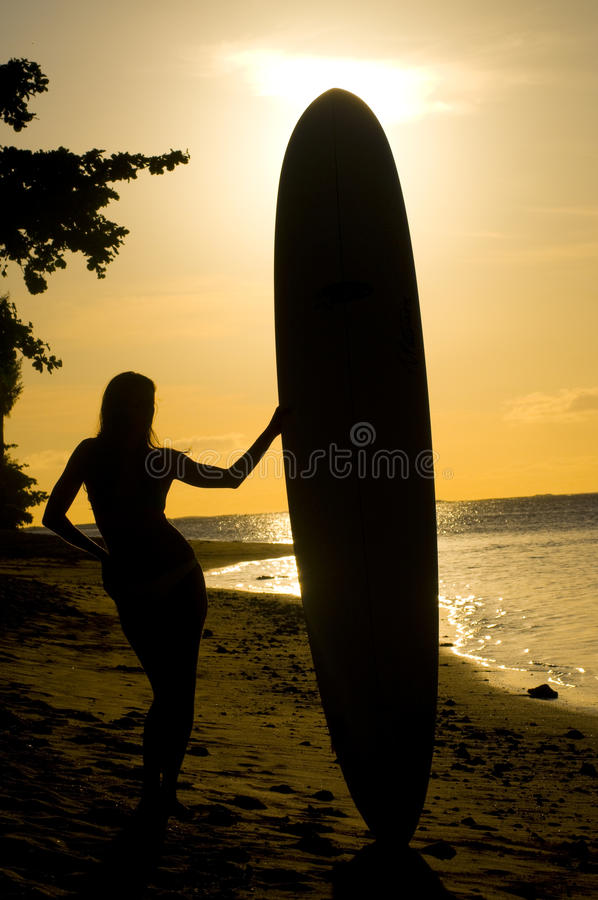 Female surfer silhouette stock photography