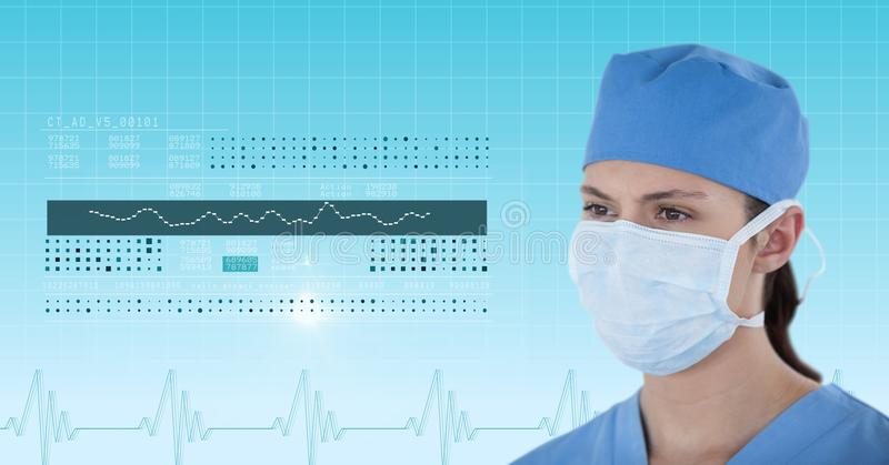 Female surgeon looking at medical graphics royalty free stock image