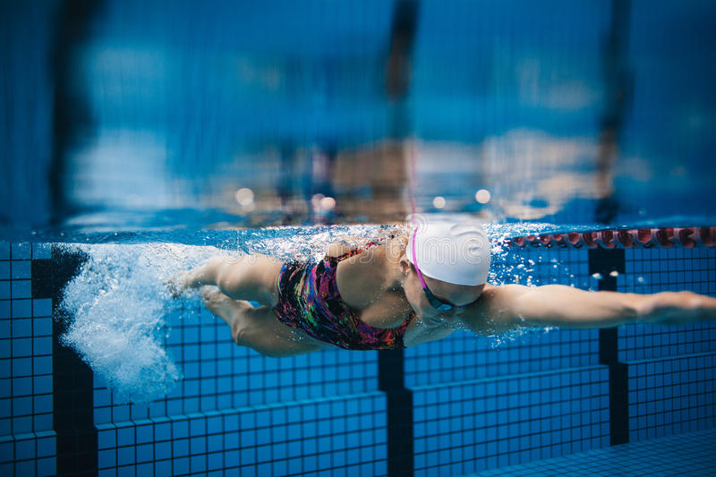 download female swimmer in action inside swimming pool stock image image 83939525 - Inside Swimming Pool