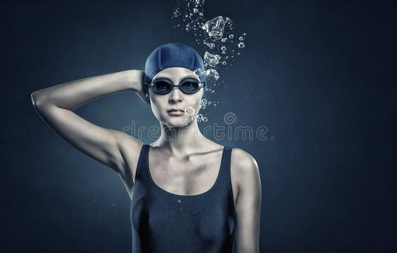 Female swimmer. Concept image. Portrait of woman swimmer in cap and glasses royalty free stock images