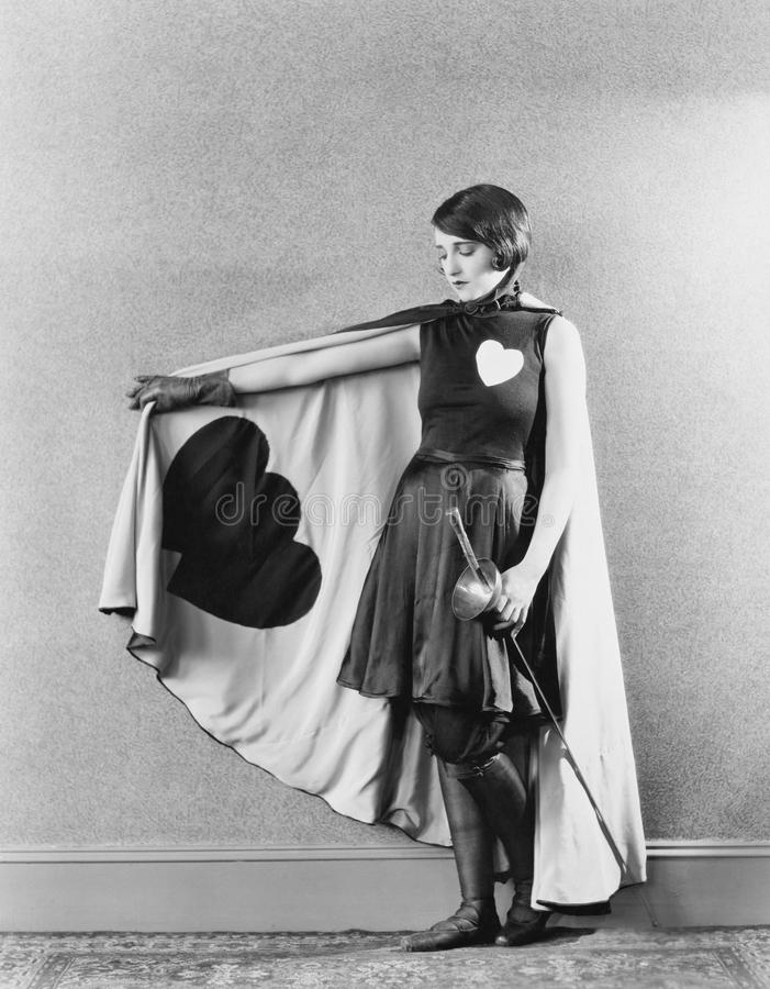 Female sword fighter wearing cape with hearts stock images