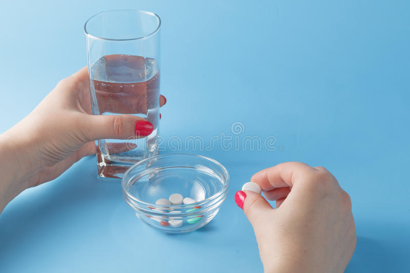 Female take pills royalty free stock photography