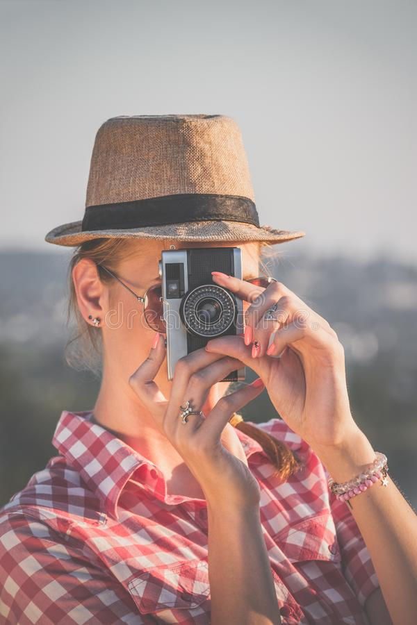 Female taking photo with retro camera royalty free stock images