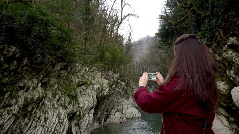 Female taking photos at Canyon Devil`s Gate in Sochi, Russia. stock images