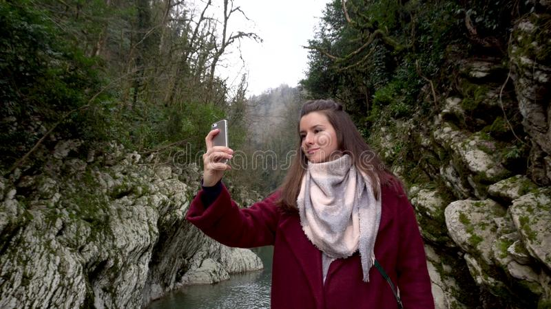 Female taking photos at Canyon Devil`s Gate in Sochi, Russia. stock photo