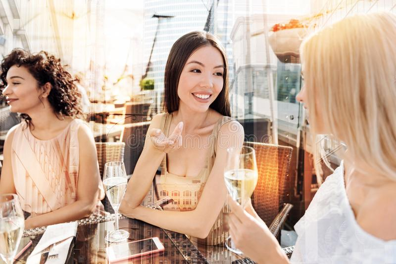 Beautiful delighted women having a conversation stock photography