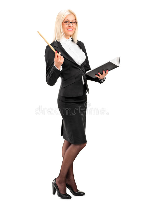 Female teacher posing with a book in her hand royalty free stock image