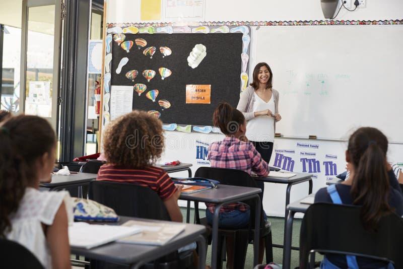 Female teacher taking elementary school class royalty free stock photography