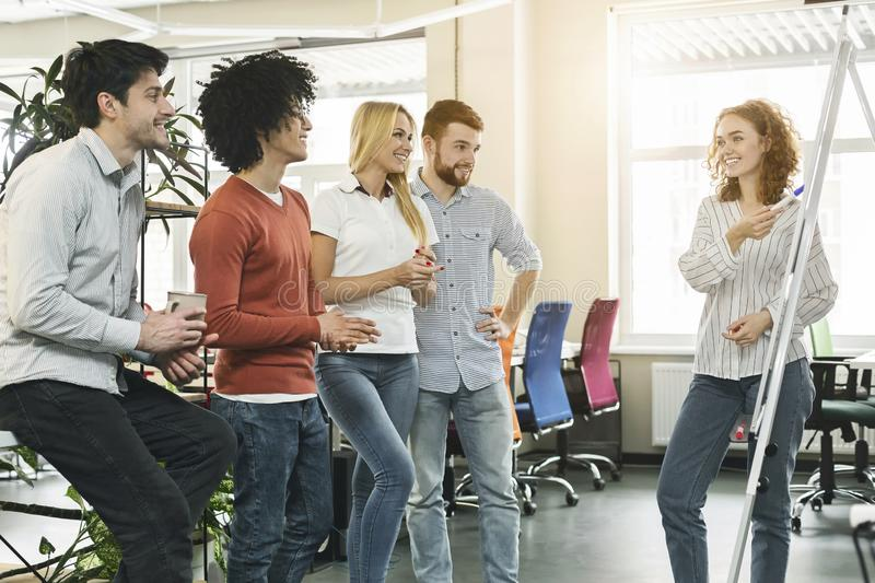Female team leader making presentation for colleagues in office royalty free stock photo