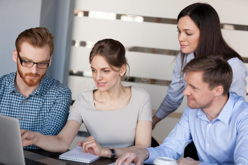Female team leader teaching explaining online project to busines. Female team leader mentor teaching explaining online project to business people group listening royalty free stock images