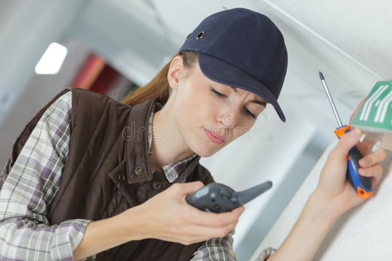 Female technician using walkie talkie. Female technician using a walkie talkie royalty free stock image