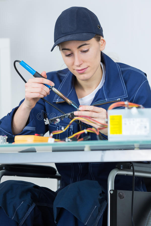 Female technician working on electronic circuit stock photography
