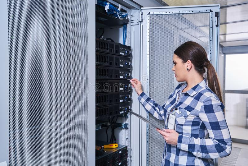 Female technician working on server maintenance royalty free stock photo