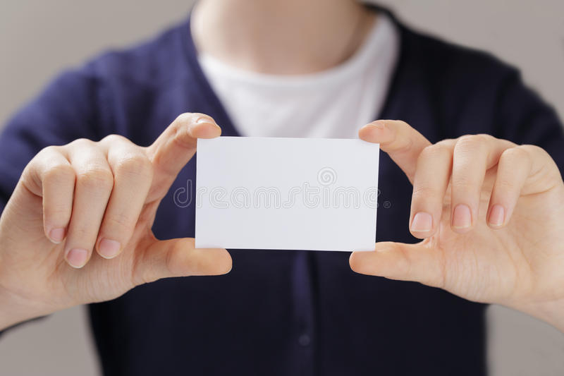 Female teen hands holding business card stock photo
